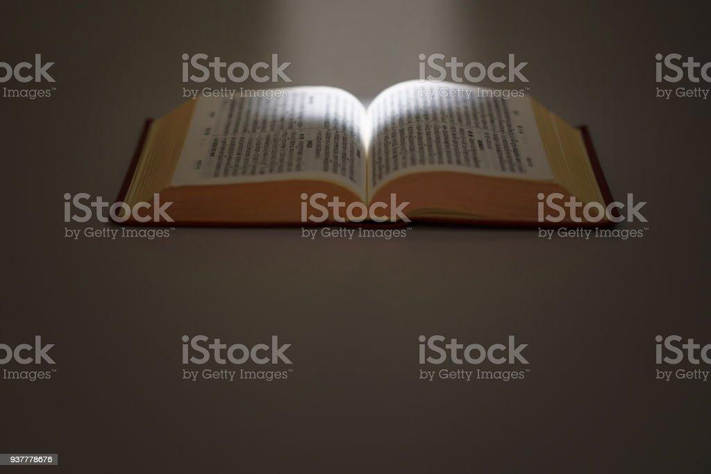 light beam and Chinese bible stock photo
