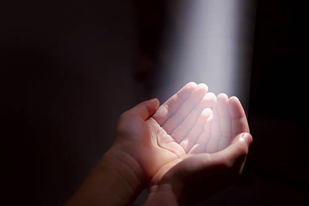 light beam and hands stock photo
