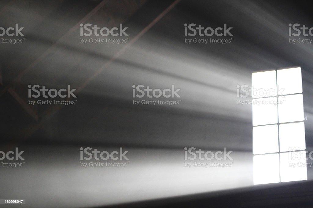Light Beams Through an Attic Window= stock photo