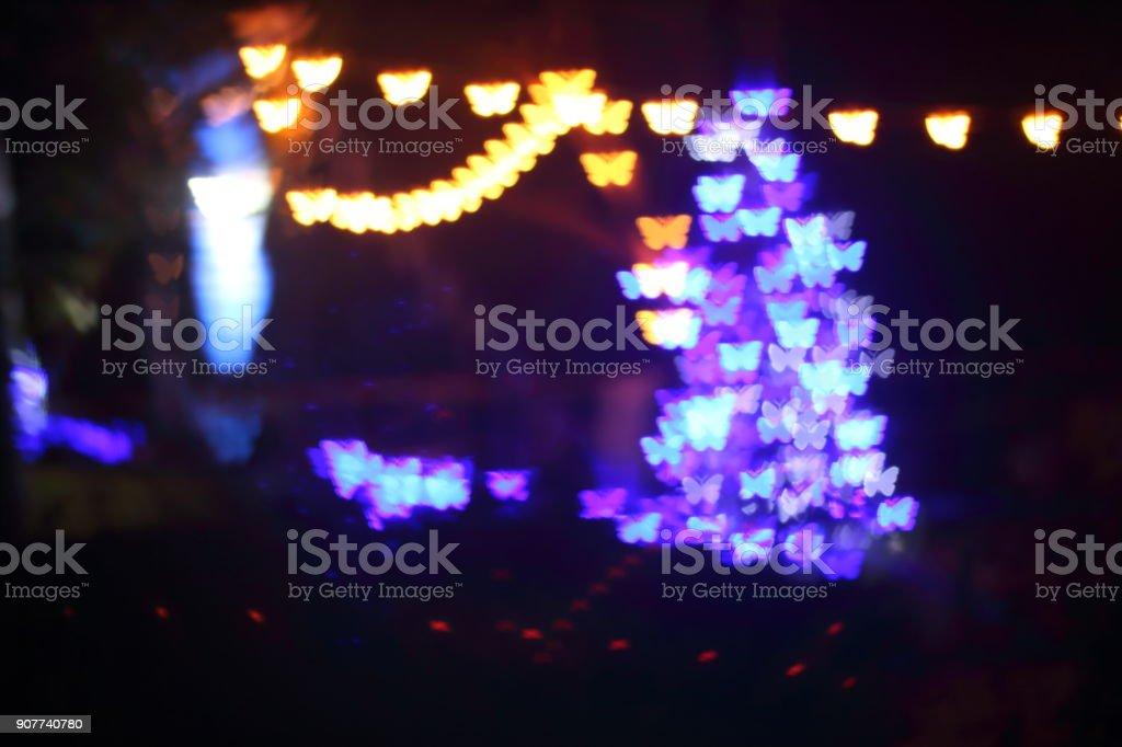 Light, beautiful bokeh butterfly shaped and blur at night. stock photo