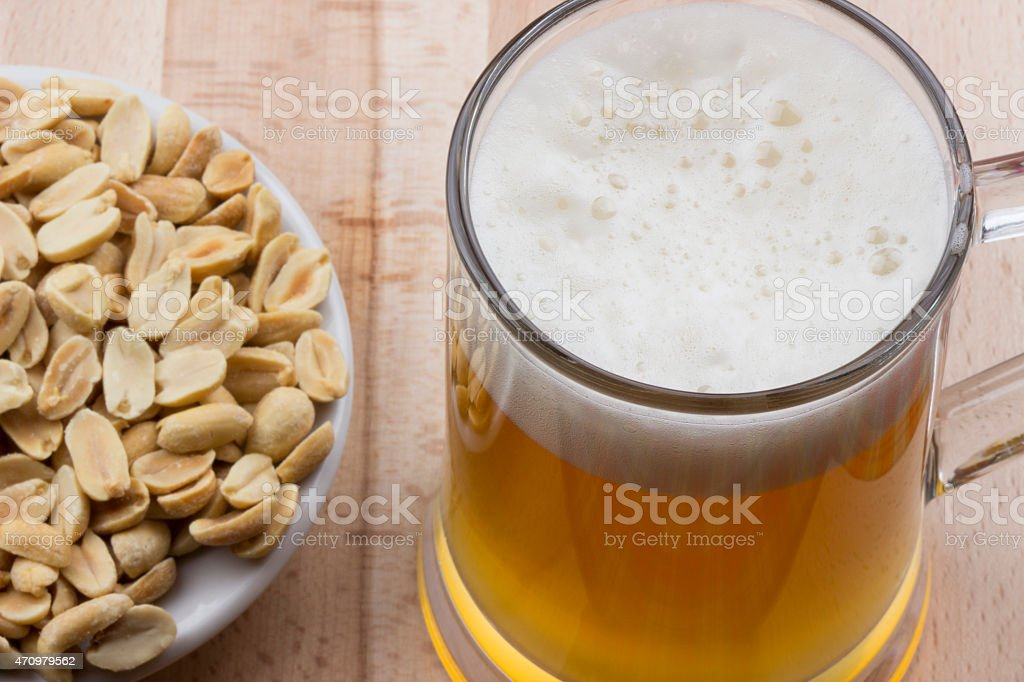 Light beer and roasted peanuts stock photo