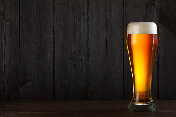 light beer glass - beer glass stock photos and pictures