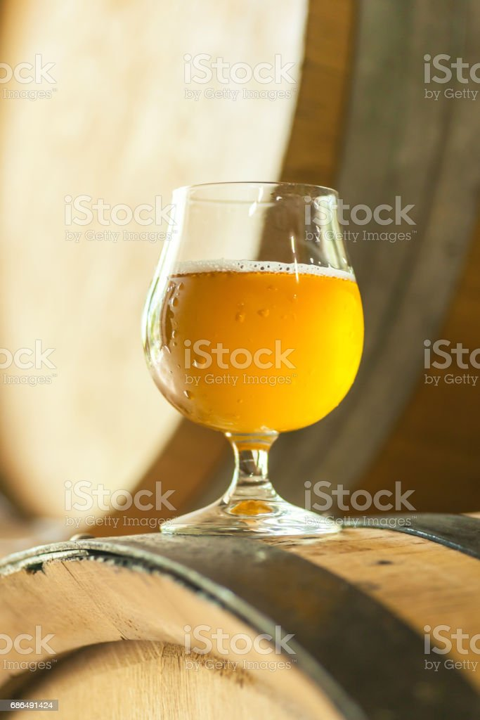 Light beer on a barrel stock photo