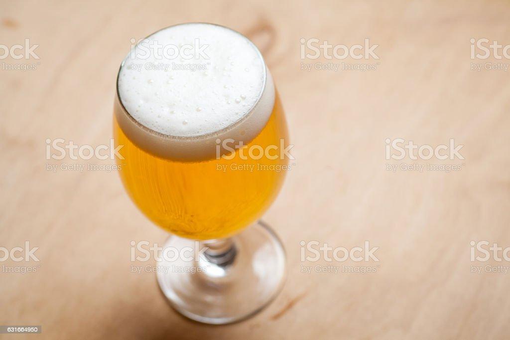 Light beer on wood stock photo