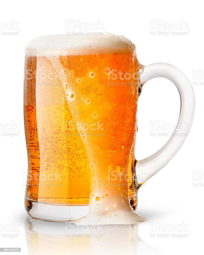Light beer with foam in mug royalty-free stock photo