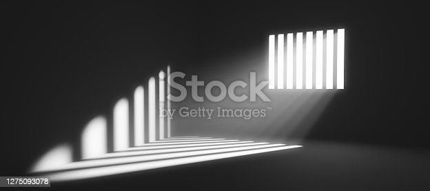 istock Light behind prison cell bars. Jail punishment and imprisonment 1275093078