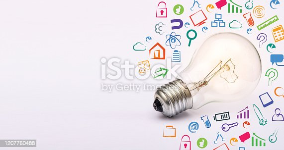 istock Light blub with startup business icons all around banner template 1207760488