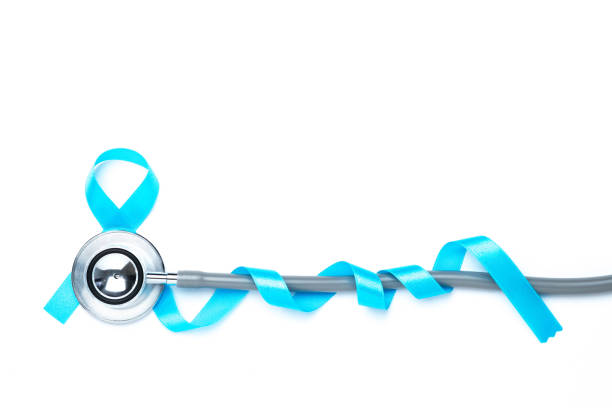 light blue awareness ribbon and a stethoscope for prostate cancer awareness campaign and men's health concept in November and September month. stock photo