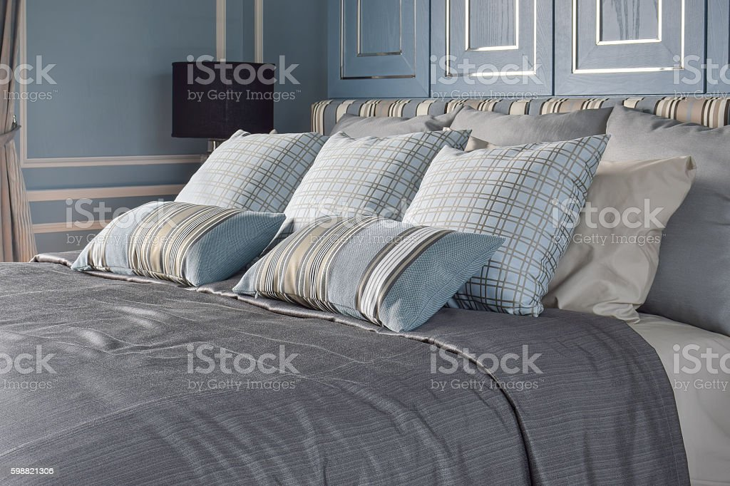 Light blue bedroom with pattern and texture of bedding stock photo