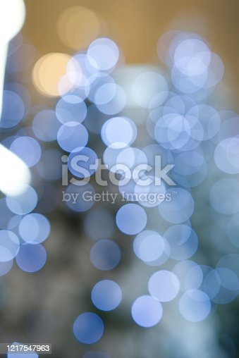 istock Light blue bokeh On a soft orange background Shot with lens blur Used as an illustration 1217547963