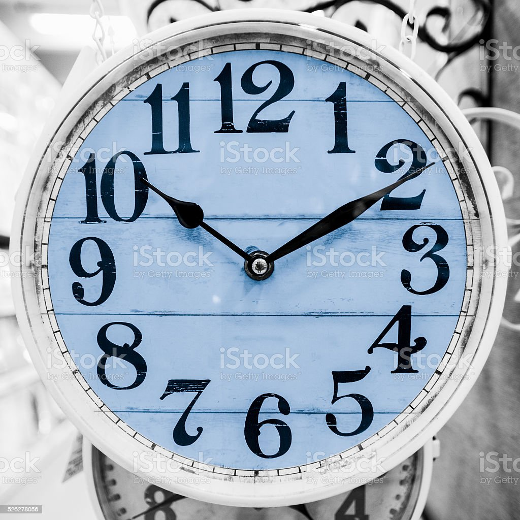 Light blue clock in a classical style. stock photo