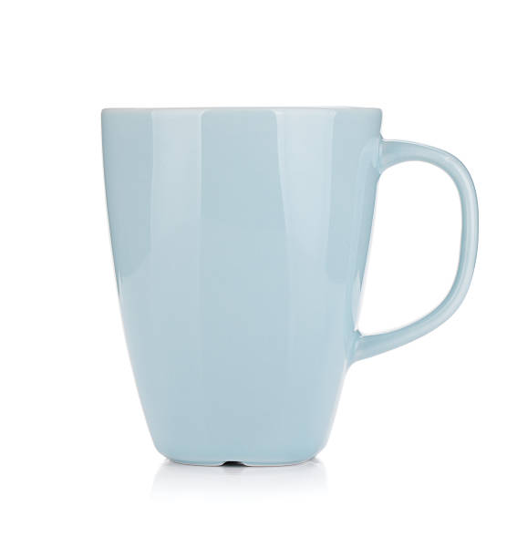 A light blue coffee cup on a white background stock photo