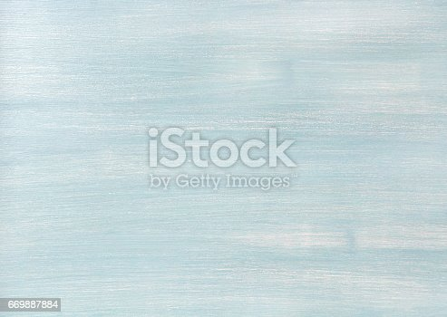istock Light blue faded painted wooden texture, background and wallpaper 669887884