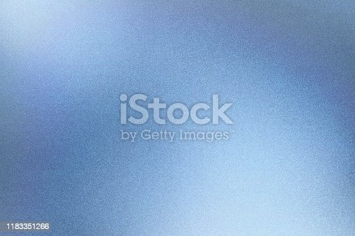Light blue foil glitter metallic wall with rough surface, abstract texture background
