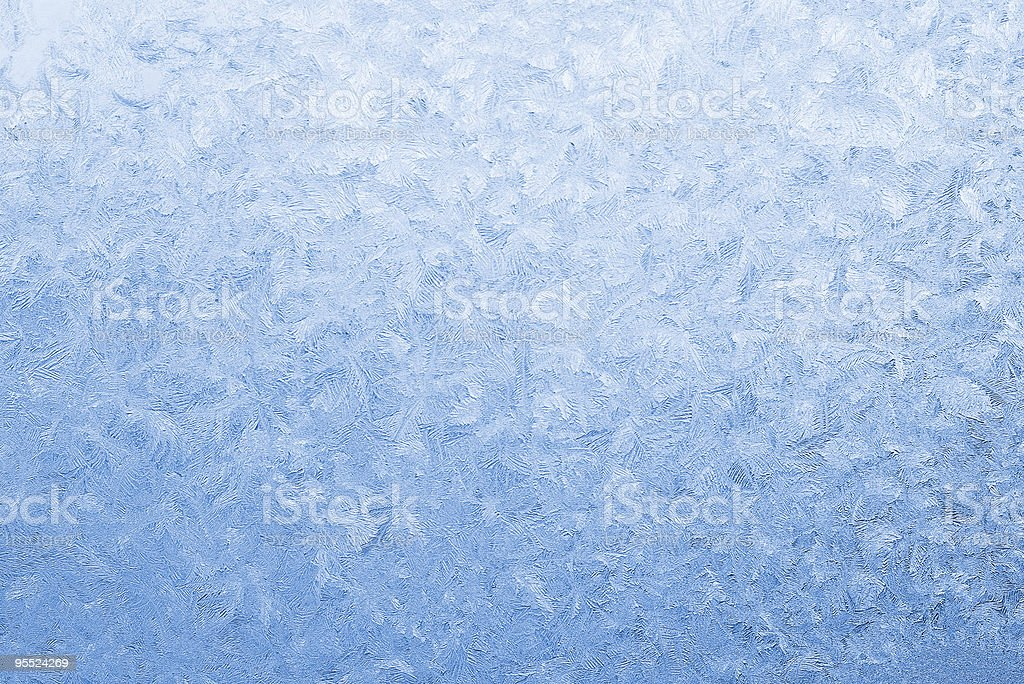 Light blue frozen window glass stock photo