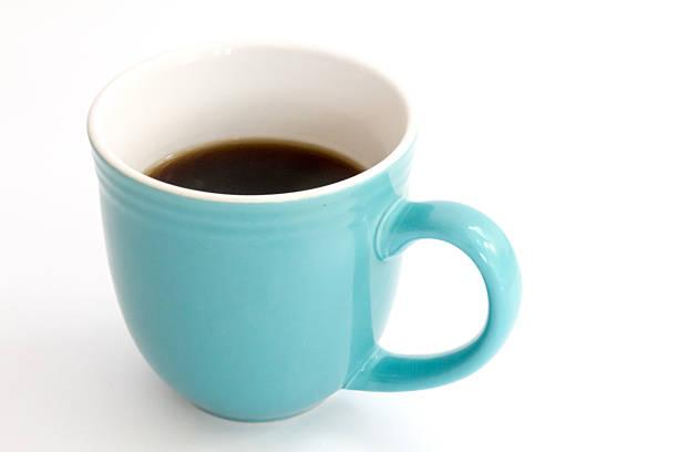 Light blue full coffee mug isolated on white