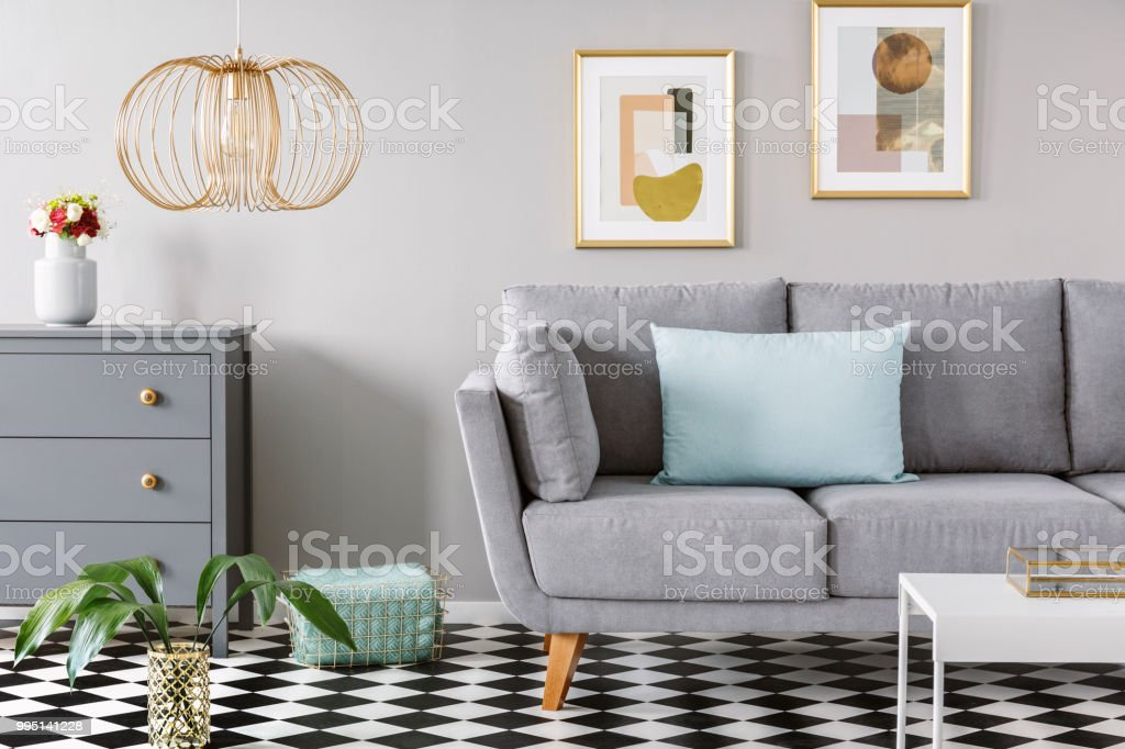 Light Blue Pillow Placed On Grey Couch In Bright Living Room
