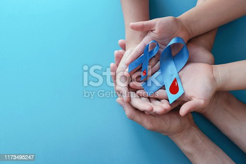istock Light blue ribbons with blood on blue background , world diabetes day 1173495247