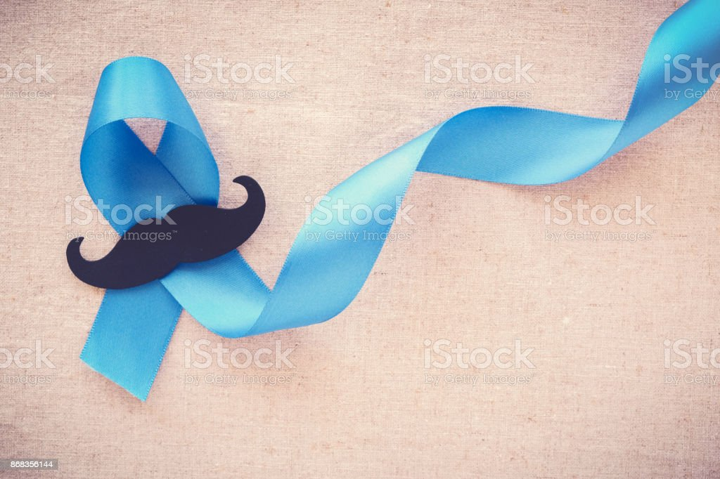 Light blue ribbons with mustache , Prostate Cancer Awareness, Men health awareness, Movember month stock photo