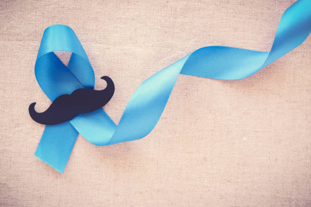 Light blue ribbons with mustache , Prostate Cancer Awareness, Men health awareness, Movember month Light blue ribbons with mustache , Prostate Cancer Awareness, Men health awareness, Movember month prostate gland stock pictures, royalty-free photos & images