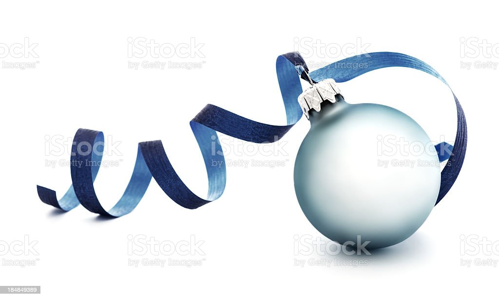 A light blue round Christmas ornament with a blue ribbon royalty-free stock photo