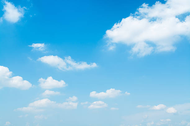 light blue sky. - skies stock photos and pictures