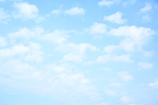 Light blue sky with clouds stock photo