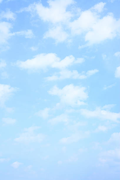 light blue spring sky - vertical stock pictures, royalty-free photos & images