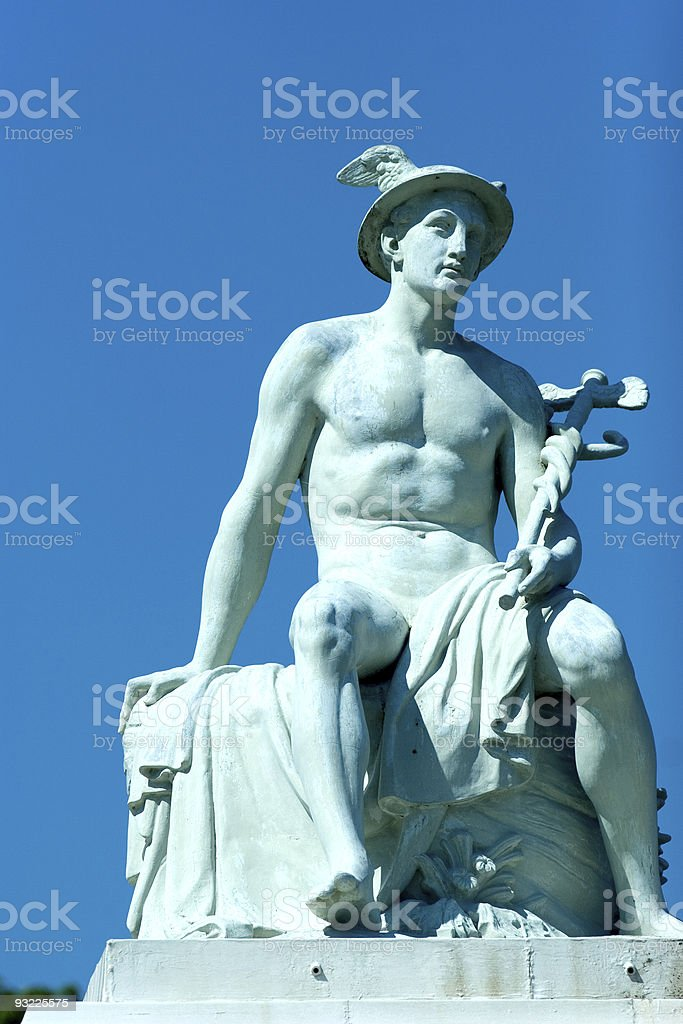 A light blue statue of Hermes, outside on a clear day stock photo