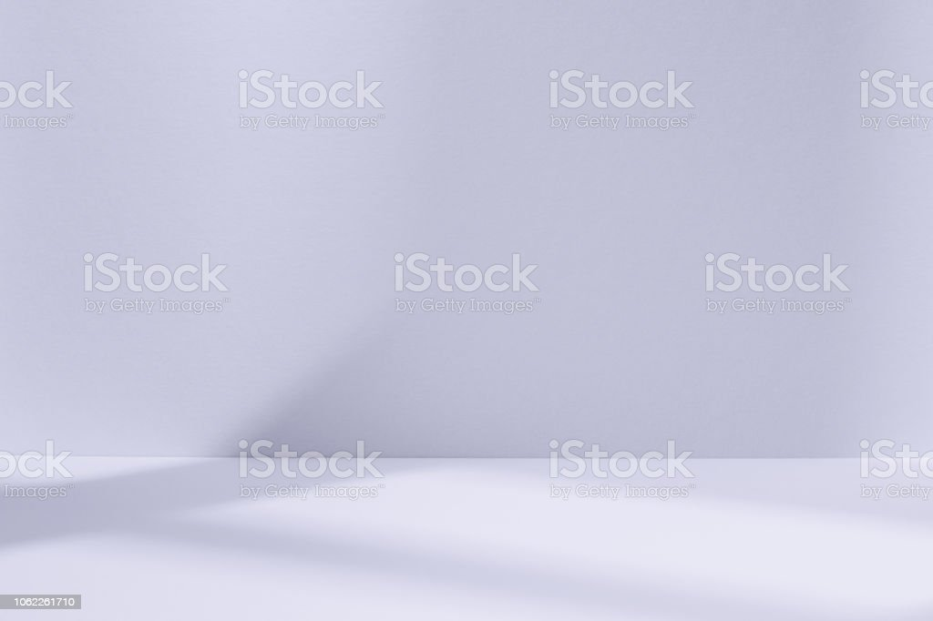 Light blue studio space with window shadow royalty-free stock photo