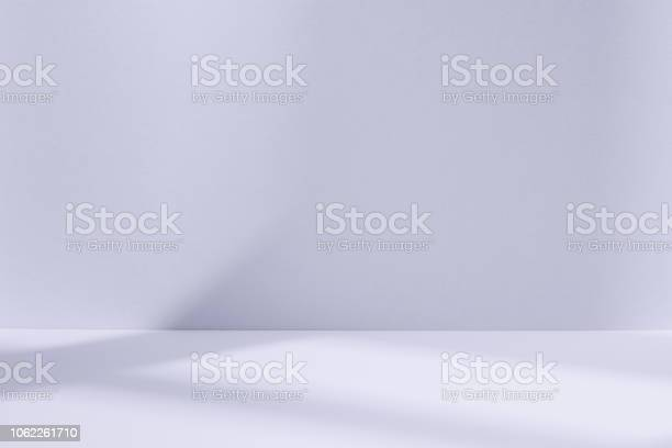 Photo of Light blue studio space with window shadow