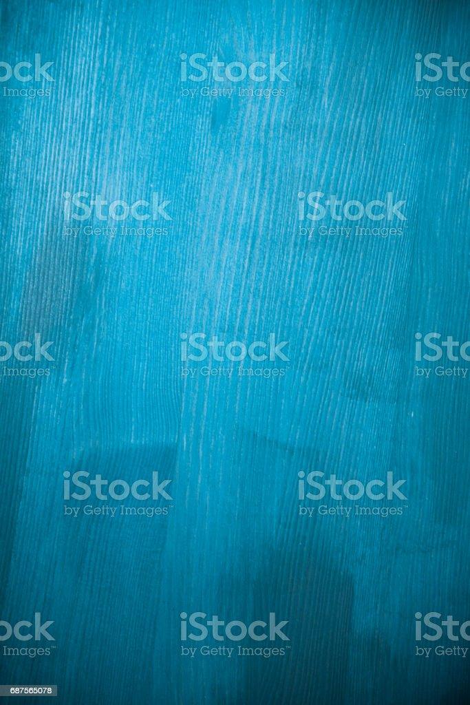 Light blue wood texture. Light blue wood background. Closeup view of blue wood texture and background. Abstract background and texture for designers. Texture of vintage handmade table. Rustic table. stock photo