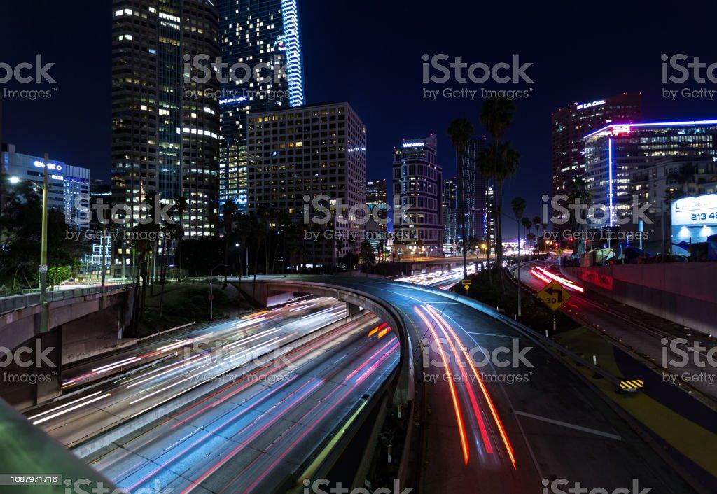 Light Blurs of Freeway Traffic at Night in DTLA stock photo