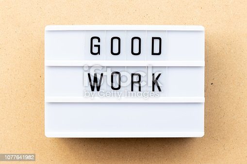istock Light box with word good work on wood background 1077641982