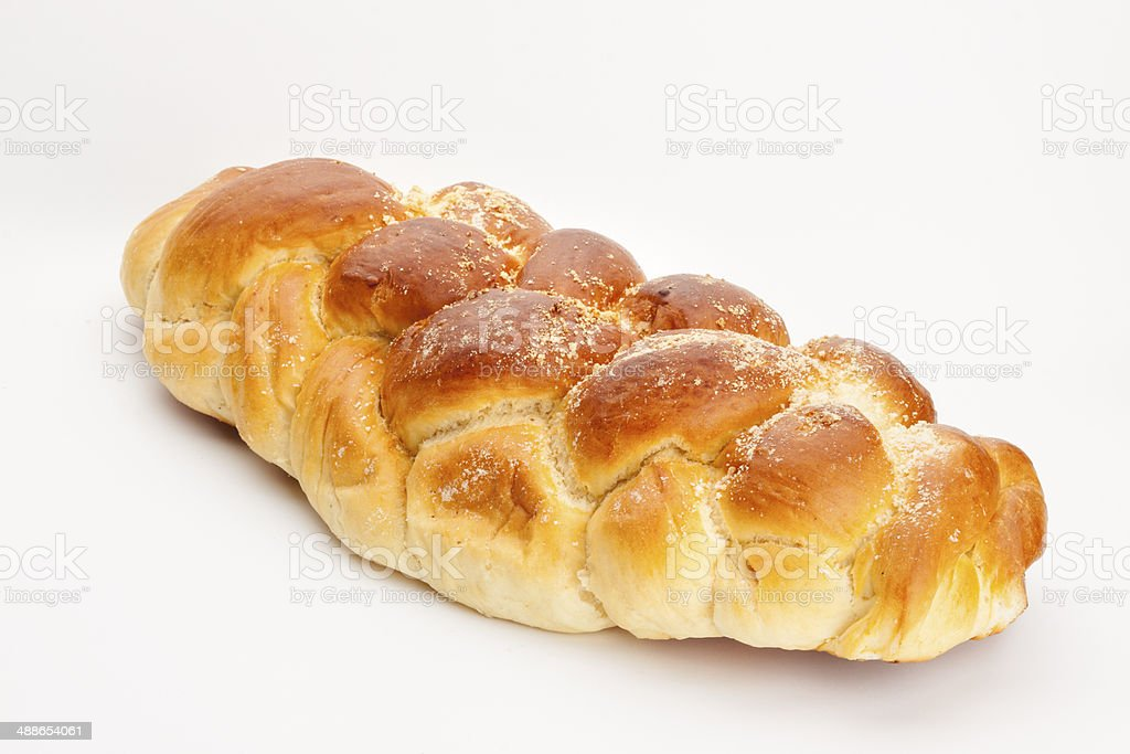 Light braided challah isolated on white background stock photo