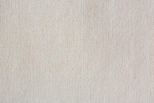 Light bright white canvas texture on macro. High resolution photo.