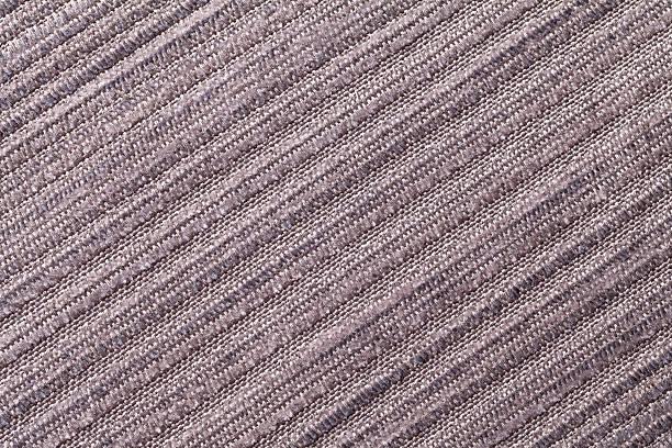 light brown background of a knitted textile material. - hausgemachte teppichreiniger stock-fotos und bilder