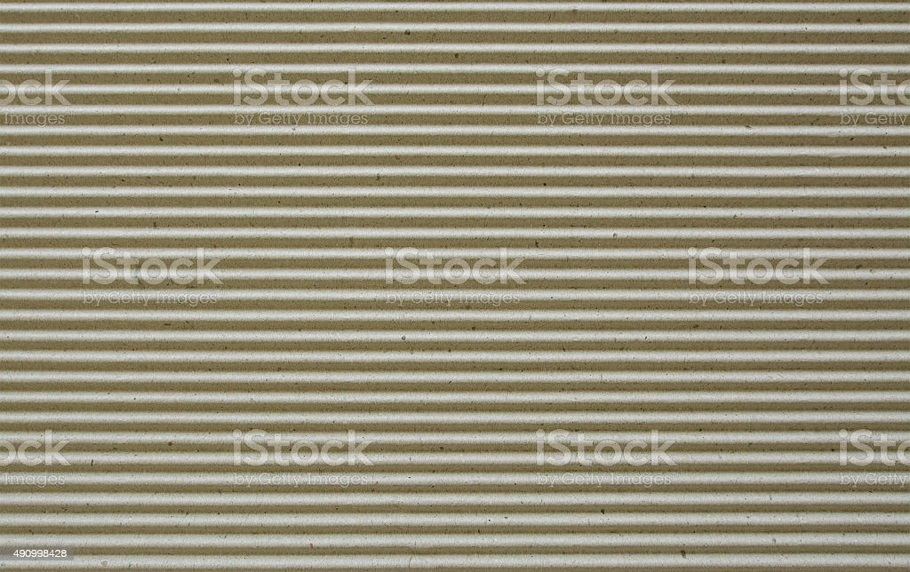 light brown corrugated paper background. stock photo