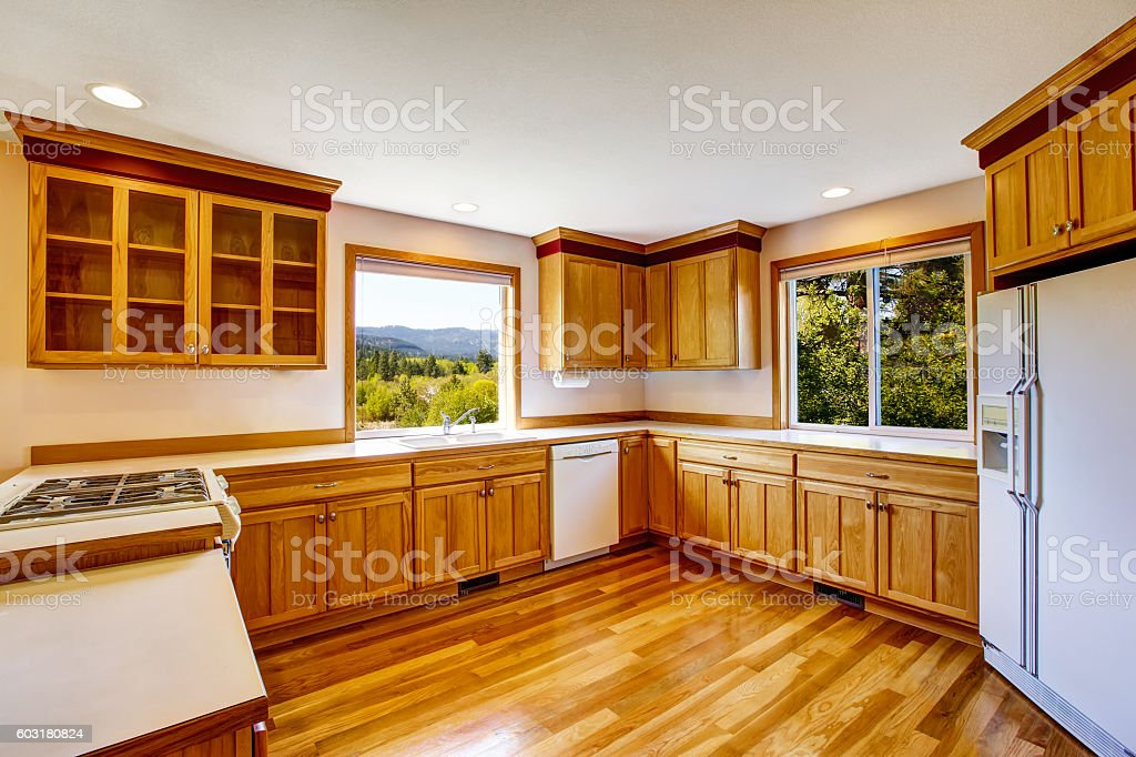 Light Brown Kitchen Cabinets White Appliances And Hardwood Floor Stock Photo Download Image Now Istock