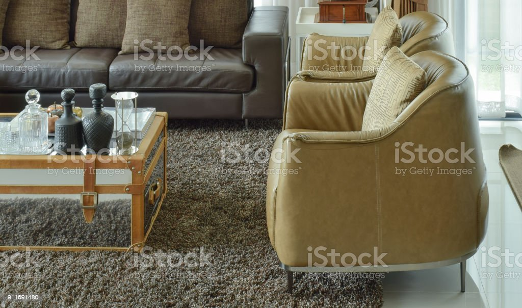 Picture of: Light Brown Leather Armchairs And Dark Brown Leather Sofa In The Living Room With Area Rug Stock Photo Download Image Now Istock