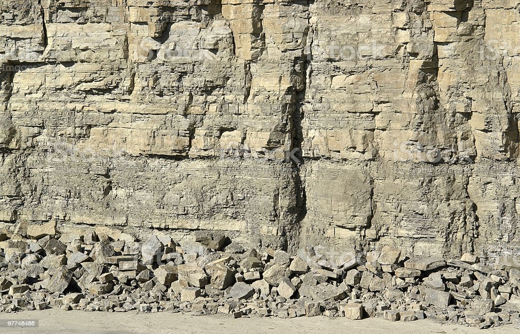 light brown stone pit wall stock photo