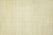 Light brown synthetic weave background.