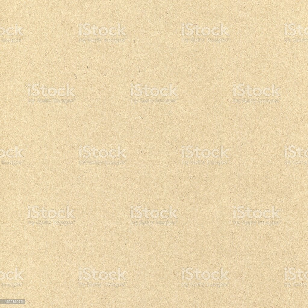 Light brown textured paper background stock photo