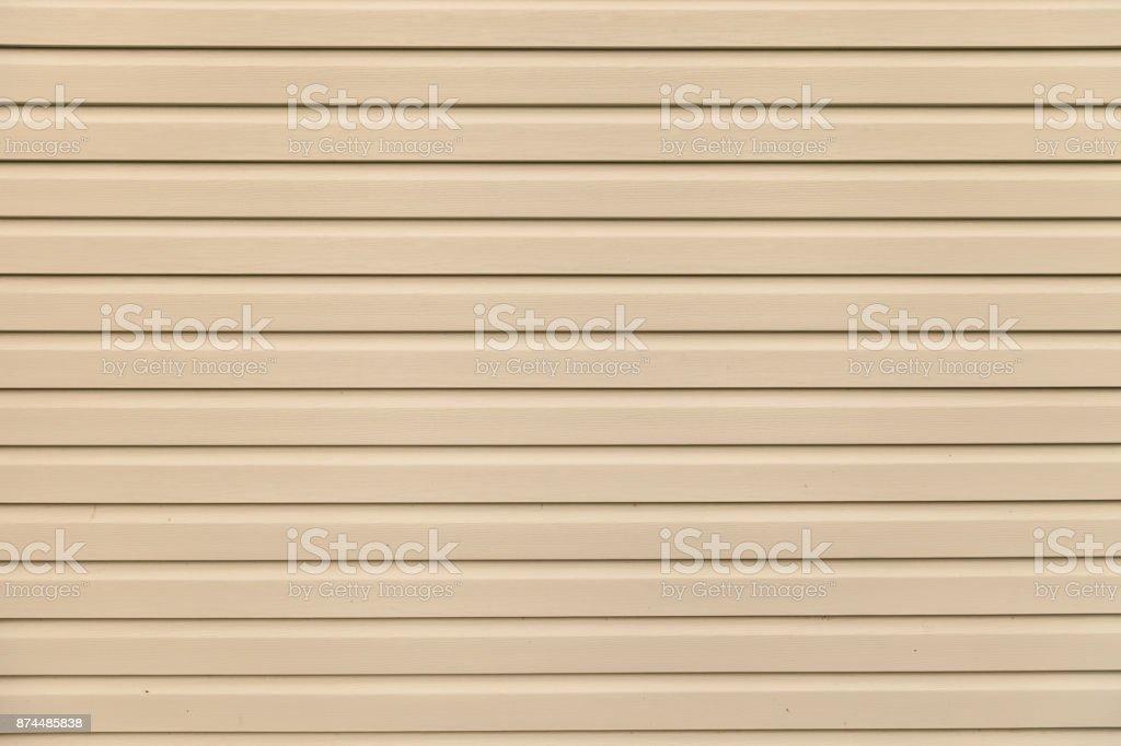 Light brown (beige) vinyl siding panel stock photo
