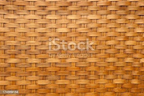 istock Light brown woven bamboo texture 174359134