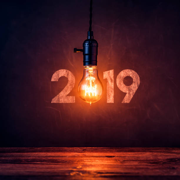Light bulb 2019 on blackboard - Christmas Vintage New Year Grunge stock photo