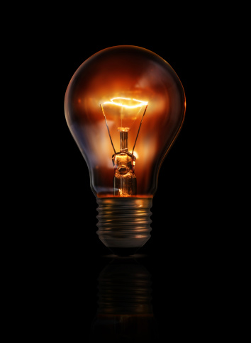 Light Bulb And Glowing Filament Stock Photo - Download Image Now