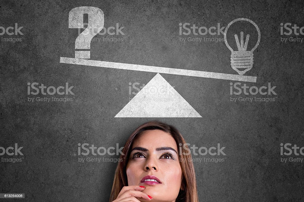 Light bulb and question mark on weight scale stock photo