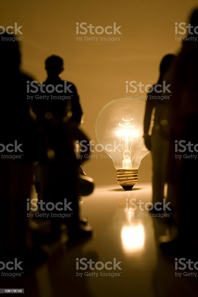 Light bulb and silhouettes of people royalty-free stock photo