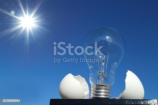 637797672istockphoto light bulb and the egg shell close up in the sunshine 503989994